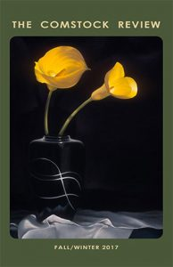 Comstock Review fall/winter 2017 cover showing two elegant yellow flowers against a black background